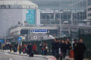 Passengers and airport staff are evacuated from the terminal building after explosions at Brussels Airport in Zaventem near Brussels, Belgium, 22 March 2016.  EPA/LAURENT DUBRULE