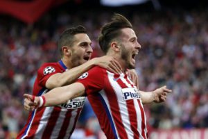 Atletico Madrid's player Saul Niguez (R) celebrates with Koke (L) after scoring the opening goal during the UEFA Champions League semifinal first leg soccer match between Atletico Madrid and Bayern Munich played at the Vicente Calderon stadium, in Madrid, Spain, 27 April 2016.  EPA/Juan Carlos Hidalgo