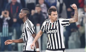 Mario Mandzukic of Juventus exults after scoring the goal of 1-0 during the Italian serie A soccer match Juventus FC - Empoli FC at Juventus Stadium, Turin, 02 April 2016. ANSA / ALESSANDRO DI MARCO