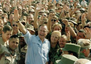 FILE -- In this Nov. 22, 1990 file photo, President George Bush poses with soldiers during a stop at an air base in Dhahran, Saudi Arabia. (ANSA/AP Photo/J. Scott Applewhite, File)