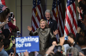 Democratic U.S. presidential candidate and former U.S. Secretary of State Hillary Clinton arrives with her husband, former U.S. President Bill Clinton (rear), to speak to supporters during her five state primary night rally held in Philadelphia, Pennsylvania , U.S., April 26, 2016.  REUTERS/Charles Mostoller - RTX2BSX6