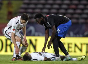 Dinamo Bucharest's Dorin Rotariu (L) and Victoria's Alexandru Buzbjuchi (R) give assistance to Dinamo's player  Patrick Claude Ekeng (down), who collapsed during the play-off soccer match Dinamo Bucharest vs Victoria, counting for the Romanian Premier Soccer League, on National Arena Stadium in Bucharest, Romania, 06 May 2016. EPA/-