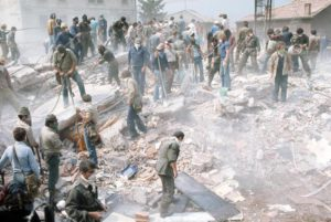 People outside their destroyed houses after a massive earthquake in Friuli region, Italy, 7 May 1976. ANSA/OLDPIX