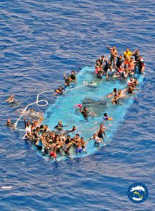 A handout picture released by the European Union Naval Force - Mediterranean (Eunavformed) on 26 May 2016 shows people in stress on their overturned boat in Canal of Sicily off the Libyan coast, 25 May 2016. The Italian navy said it had recovered five bodies from the overturned migrant ship. Over 550 migrants on board were rescued safely.  EPA/EUNAVFOR MED OHQ