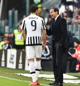 Spanish forward Alvaro Morata of Juventus Fc speaks to Juventus' head coach Massimiliano Allegri (R) during Italian Serie A soccer match Juventus Fc-Hellas Verona at the Juventus Stadium, Turin, 6 January 2016.  ANSA / DI MARCO