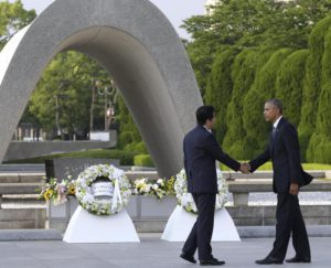 U.S. President Barack Obam, right, and Japanese Prime Minister Shinzo Abe shake hands after laying wreaths at Hiroshima Peace Memorial Park in Hiroshima, western, Japan, Friday, May 27, 2016. Obama on Friday became the first sitting U.S. president to visit the site of the world's first atomic bomb attack, bringing global attention both to survivors and to his unfulfilled vision of a world without nuclear weapons. Atomic Bomb Dome is seen in the background. (ANSA/AP Photo/Carolyn Kaster)