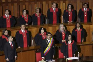 Venezuela's President Nicolas Maduro (front C) attends a ceremony to mark the opening of the judicial year at the Supreme Court of Justice (TSJ), next to Venezuela's Supreme Court President Gladys Gutierrez (front R), in Caracas, January 29, 2016. REUTERS/Marco Bello
