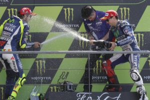Spanish Moto GP rider Jorge Lorenzo (R) of Movistar Yamaha celebrates his victory on the podium with second placed Italian team mate Valentino Rossi (L) and team boss Kouichi Tsuji  after the MotoGP race of the French motorcycling Grand Prix at Le Mans race track, Le Mans, France, 17 May 2015.  ANSA/EDDY LEMAISTRE