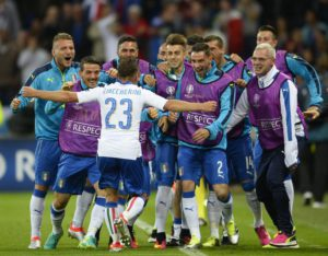 Emanuele Giaccherini (L) of Italy celebrates with teammates after scoring the 1-0 goal during the UEFA EURO 2016 group E preliminary round match between  Belgium and Italy at Stade de Lyon in Lyon, France, 13 June 2016.