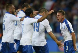 Emanuele Giaccherini (R) of Italy celebrates with teammates after scoring the 1-0 goal during the UEFA EURO 2016 group E preliminary round match between  Belgium and Italy at Stade de Lyon in Lyon, France, 13 June 2016.