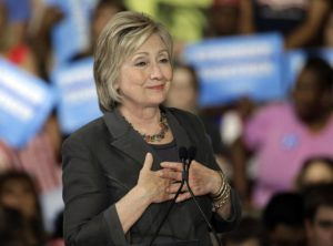 "Democratic presidential candidate Hillary Clinton gestures as she ""sighs"" talking about Republican presidential candidate Donald Trump during a rally in Raleigh, N.C., Wednesday, June 22, 2016. (ANSA/AP Photo/Chuck Burton)"