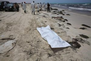 A body bag lies on the beach as rescue personnel work where bodies of migrants washed up, in Zuwarah, west of Tripoli, Libya, 02 June 2016 EPA/MOHAME BEN KHALIFA