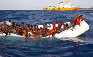A handout photgraph made available by the Ong Sos Méditerranée showing migrants on a snking inflatable boat before being rescued by  the Aquarius ship of the humanitarian group SOS Mediterranee, and taken to  Lampesusa, Italy, 18 April 2016. EPA/ONG SOS MEDITERRANEE