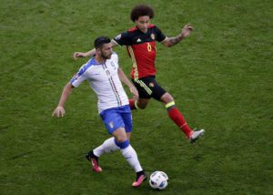 Graziano Pelle of Italy (L) and Axel Witsel of Belgium in action during the UEFA EURO 2016 group E preliminary round match between  Belgium and Italy at Stade de Lyon in Lyon, France, 13 June 2016.