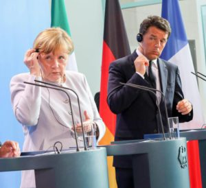 German Chancellor Angela Merkel (C) speaking alongside French President Francois Hollande (L) and Italian Prime Minister Matteo Renzi at a press conference, after meetings in the wake of Britain's referendum vote to leave the EU, in Berlin, Germany, 27 June 2016.  EPA/KAY NIETFELD