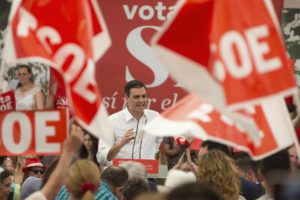 Party supporters wave flags as Spanish Socialist leader Pedro Sanchez takes to the stage during an election rally on the last day of campaigning, in Madrid, Spain, Friday June 24, 2016. (ANSA/AP Photo/Paul White)