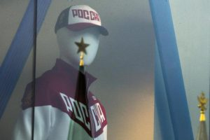 A mannequin dressed in a Russian Olympics National team uniform is on display in a shop window, with the Kremlin tower star reflected on a window glass, in Moscow, Russia, Tuesday, July 19, 2016. (ANSA/AP Photo/Pavel Golovkin)
