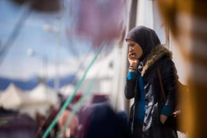 A migrant woman uses her mobile phone at the refugee camp of Idomeni, near the Greek border with Macedonia, in northern Greece, 08 March 2016. EPA/Zoltan Balogh