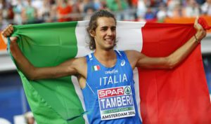 Italy's Gianmarco Tamberi celebrates after winning the gold medal in the men's high jump during the European Athletics Championships in Amsterdam, the Netherlands, Sunday, July 10, 2016. (ANSA/AP Photo/Matthias Schrader)