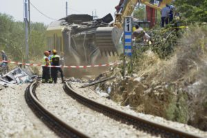 The trains wreckage are removed at the site of the head-on commuter train collision that occurred Tuesday between the towns of Andria and Corato, in the southern Puglia region, Italy, 13 July 2016. ANSA/ GAETANO LO PORTO