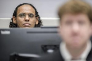 Ahmad Al Faqi Al Mahdi appears at the International Criminal Court in The Hague, Netherlands, Monday, Aug. 22, 2016, at the start of his trial on charges of involvement in the destruction of historic mausoleums in the Malian desert city of Timbuktu. (ANSA/AP Photo/Patrick Post, Pool)