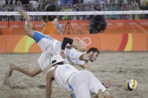 Italy's Paolo Nicolai, above, can't reach a ball as teammate Daniele Lupo looks on while playing against Brazil during the men's beach volleyball gold medal match at the 2016 Summer Olympics in Rio de Janeiro, Brazil, Friday, Aug. 19, 2016. (ANSA/AP Photo/Petr David Josek)