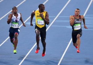Jamaica's Usain Bolt, center, smiles as he looks at Canada's Andre De Grasse, right, during a semifinal in the men's 100 meters at the Olympic Summer Games in Rio de Janeiro, Brazil, on Sunday, Augl. 14, 2016. Britain's Chijindu Ujah is at left. (Sean Kilpatrick/The Canadian Press via AP)
