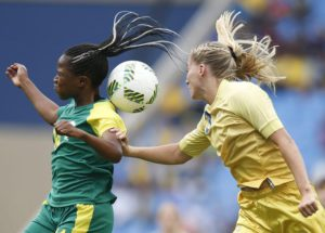 Linda Sembrant (R) of Sweden in action against Sanah Mollo of South Africa  during the women's first round match between Sweden and South Africa of the Rio 2016 Olympic Games Soccer tournament at the Olympic Stadium in Rio de Janeiro, Brazil, 03 August 2016.  EPA/YOAN VALAT