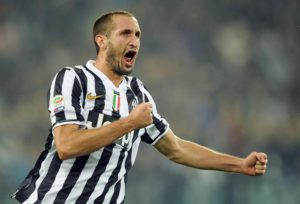 Juventus defender Giorgio Chiellini celebrates after scoring the 3-1 lead during the Serie A soccer match between Juventus and AC Milan at the Juventus stadium in Turin, Italy, 6 October 2013. ANSA/DI MARCO
