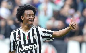 Juan Cuadrado of Juventus FC celebrates after scoring the 3-0 goal during Italian Serie A soccer match between Juventus Fc and Us Palermo at the Juventus stadium in Turin, 17 April 2016. ANSA / DI MARCO