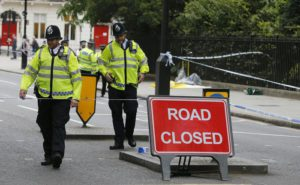 Police guard the scene of a knife attack near Russell Square in London, Thursday, Aug. 4, 2016. Terrorism is being examined as a potential motive for a knife rampage at Russell Square, central London, that left one woman dead and five others injured. (ANSA/AP Photo/Frank Augstein) [CopyrightNotice: Copyright 2016 The Associated Press. All rights reserved. This material may not be published, broadcast, rewritten or redistribu]
