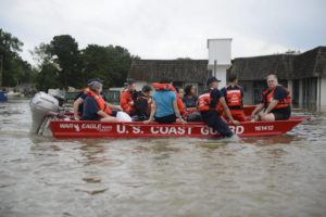 A handout picture provided by the US Coast Guard on 16 August 2016 shows members of the Coast Guard rescuing residents, during the flooding in Baton Rouge, Louisiana, USA, 14 August 2016. At least six people died and over 20,000 people had to be evacuated from their homes as 'historic' flooding hits large parts of Louisiana, media reported.  EPA/BRANDON GILES/US COAST GUARD/HANDOUT