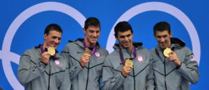 The US team with Michael Phelps (R-L), Ricky Berens, Conor Dwyer and Ryan Lochte celebrate after winning gold in the Men's 4x200m Freestyle Relay Final during the London 2012 Olympic Games Swimming competition, London, Britain, 31 July 2012.  EPA/HANNIBAL