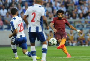 Roma's Mohamed Salah, right, attempts a shot at goal past Porto's Felipe, left, during a Champions League play-offs first leg soccer match between FC Porto and AS Roma at the Dragao stadium in Porto, Portugal, Wednesday, Aug. 17, 2016. (ANSA/AP Photo/Paulo Duarte)