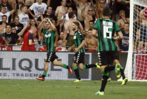 Sassuolo's Matteo Politano jubilates with his teammate Domenico Berardi after scoring the goal during the UEFA Europa League playoff soccer match between Italian Club US Sassuolo and Serbian Red Star Belgrade at Mapei Stadium in Reggio Emilia,Italy,18 August 2016.ANSA/ELISABETTA BARACCHI