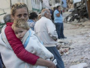 A mother embraces his son in Amatrice, central Italy, where a 6.1 earthquake struck just after 3:30 a.m.,Italy, 24 August 2016.ANSA/ MASSIMO PERCOSSI