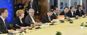 "(LtoR) Dutch Prime minister Mark Rutte, German Chancellor Angela Merkel, EU Commission President Jean Claude Juncker, European Central Bank chief Mario Draghi, French President Francois Hollande, Spanish Prime minister Mariano Rajoy, Greek Prime Minister Alexis Tsipras and Italian Prime Minister Matteo Renzi attend to an Eurozone Summit meeting at the EU headquarters in Brussels on July 7, 2015. Eurozone nations showed the ""political will"" to help Greece reach a bailout deal at emergency talks in Brussels despite a referendum that rejected creditors' terms, new Greek finance minister Euclid Tsakalotos said. AFP PHOTO/ JOHN THYS        (Photo credit should read JOHN THYS/AFP/Getty Images)"