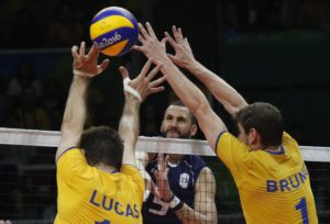 Ivan Zaytsev of Italy (C) spikes the ball against Lucas Saatkam (L) and Bruno Mossa Rezende (R) of Brazil during the men's Volleyball gold medal match of the Rio 2016 Olympic Games at Maracanazinho indoor arena in Rio de Janeiro, Brazil, 21 August 2016.  EPA/JAVIER ETXEZARRETA