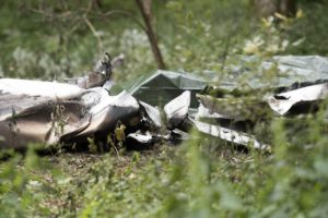 A general view shows debris from a burned Piper PA-32 which crashed on 14 July, in the woods at Predmeja village near Ajdovscina, some 50 kilometers west of Ljubljana, Slovenia, 15 July 2016.  EPA/IGOR KUPLJENIK