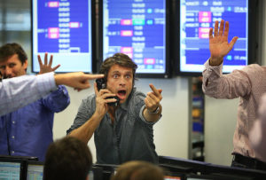 LONDON - OCTOBER 09:  A broker on ICAP's dealing floor calls for prices on October 9, 2008 in London.  Share prices are up on the day as markets react to the interest rate cut.  (Photo by Peter Macdiarmid/Getty Images)