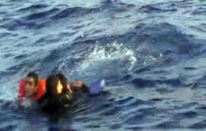 A videograb realesed by Italian Marina Militare shows scuba diver rescue of the shipwrecked by Italian marines in Sicily Canal, yesterday, 11 October 2013 were almost  50 people are dead.   ANSA/Marina Militare