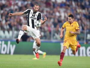 Juventus's Giorgio Chiellini, left, and Sevilla's Vitolo, right, in action during the Uefa Champions League soccer match Juventus FC vs Sevilla FC at Juventus Stadium in Turin, Italy, 14 September 2016 ANSA/ALESSANDRO DI MARCO