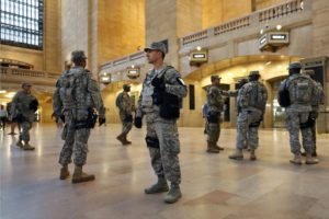 Members of the U.S. Armed Forces stand guard in Grand Central Terminal, Sunday, Sept. 18, 2016, in New York. (ANSA/AP Photo/Mary Altaffer)
