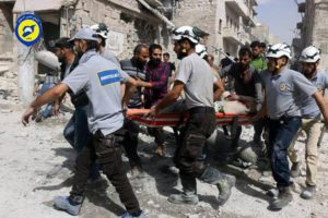 FILE - In this Wednesday, Sept. 21, 2016, file photo, provided by the Syrian Civil Defense White Helmets, rescue workers work the site of airstrikes in the al-Sakhour neighborhood of the rebel-held part of eastern Aleppo, Syria.  (Syrian Civil Defense White Helmets via AP, File)