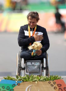 Italy's Alessandro Zanardi is overcome by emotion on the podium after winning gold in the Men's Time Trial H5 held in Pontal, during the seventh day of the 2016 Rio Paralympic Games in Rio de Janeiro, Brazil, Wednesday, Sept. 14, 2016. (Andrew Matthews/PA via AP)