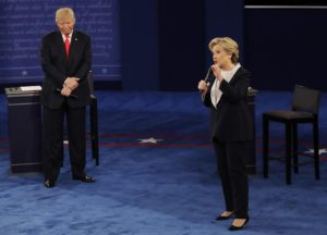 Republican presidential nominee Donald Trump listens to Democratic presidential nominee Hillary Clinton during the second presidential debate at Washington University in St. Louis, Sunday, Oct. 9, 2016. (ANSA/AP Photo/Patrick Semansky)