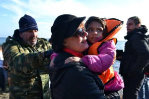 US actress Susan Sarandon carries a refugee child at the east coast of Lesvos island, Greece, 18 December 2015, at the spot where boats with migrants arrived. The actress and activist witnessed first-hand the refugees arrival and particularly helped children to change their soaked clothes, socks and shoes and supported the volunteers and the non-governmental organizations in the reception of the migrants and refugees.  EPA/PANAGIOTIS BALASKAS