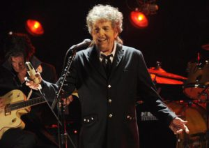 FILE  - In this Jan. 12, 2012, file photo, Bob Dylan performs in Los Angeles. Dylan was named the winner of the 2016 Nobel Prize in literature Thursday, Oct. 13, 2016, in a stunning announcement that for the first time bestowed the prestigious award to someone primarily seen as a musician. (ANSA/AP Photo/Chris Pizzello, File)