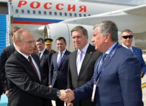 Russian President Vladimir Putin (L) shakes hands with head of Russia's top oil producer Rosneft, Igor Sechin (R) as he arrives at Ataturk airport in Istambul, Turkey. Putin is in Turkey to attend the 23rd World Energy Congress and during his visit he is expected to meet with Turkish President Recep Tayyip Erdogan to discuss possible energy and tade agreements.  EPA/ALEXEY DRUZHINYN /SPUTNIK/KREMLIN POOL