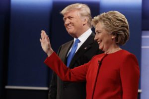 Republican presidential candidate Donald Trump, left, stands with Democratic presidential candidate Hillary Clinton before the first presidential debate at Hofstra University, Monday, Sept. 26, 2016, in Hempstead, N.Y. (ANSA/AP Photo/ Evan Vucci)